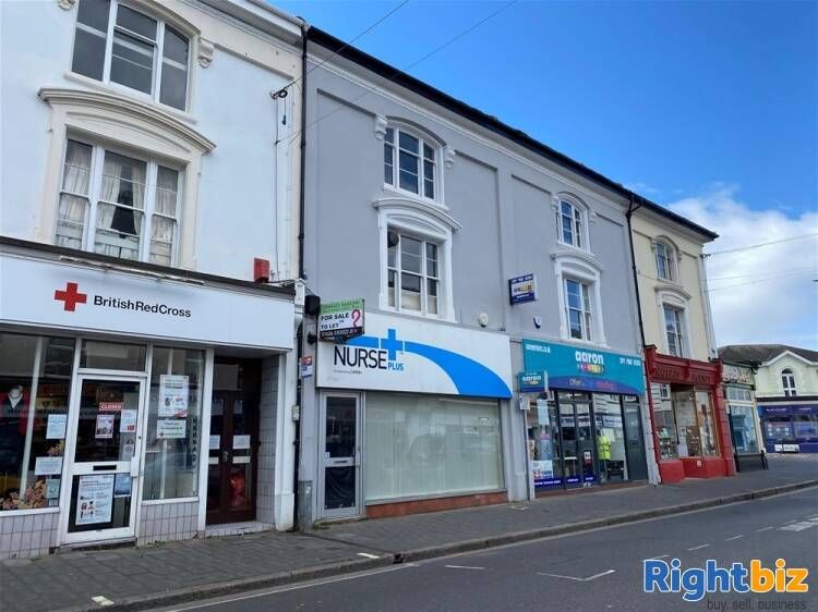 High street retail office premises and garaging, for sale by public auction 27th May 2021 For Sale in Newton Abbot - Image 1
