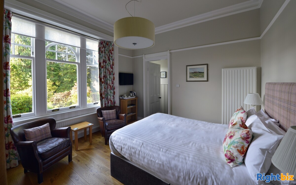 4-star gold bed & breakfast operation that sits peacefully within the picturesque highland town - Image 9
